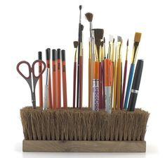 Push-broom head as a convenient drying rack for artist brushes. (or an all-around supply holder)