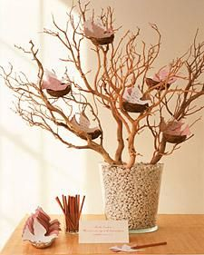 At the celebration of life have a memory tree. This one is made of manzanita branches. Place pencils alongside your tree with a sign asking guests to inscribe a memory of the departed on the card and to place it on the tree. Doves are symbols of love and harmony. The doves can be put in an envelopes and handed down to generations to come. #funeral idea, #idea for celebration of life