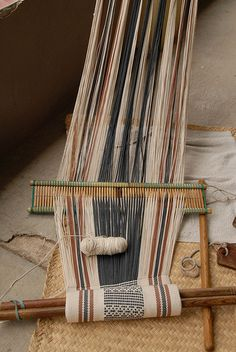 A weaver takes a break from her work in Santo Tomas Jalieza, Oaxaca Mexico