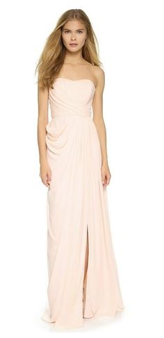 Bustier Gown A pleated Badgley Mischka Collection dress, styled with a formfitting, boned bodice and airy skirt. Off-center front slit. Non-slip rubber binding at top hem. Hidden back zip.