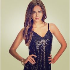 Express Black Sequined Tank Iridescent metallic gold sequins layered over stretch black jersey material. V-neckline and adjustable straps Express Tops Camisoles