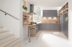 Think outside the box by creating stylish open shelving using wood-look interiors. Wild maple effect carcases and splashbacks are combined with anthracite grey vinyl-wrapped Aura doors in this kitchen design from In-toto. Prices for an Aura kitchen start at £10,000.