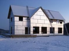 Photo of a house with rigid insulation on the exterior side of the wall sheathing