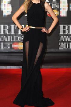 d0dae4cc5ab élégante robe de célébrité longue noire avec une fine ceinture doré et le  dos nu