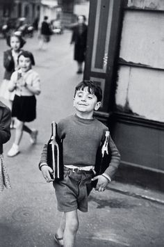 "Rue Mouffetard, Paris, 1954  Henri Cartier-Bresson  was a French photographer considered to be the father of modern photojournalism. He was an early adopter of 35 mm format, and the master of candid photography. He helped develop the ""street photography"" or ""life reportage"" style that has influenced generations of photographers who followed."