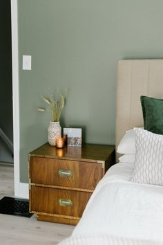 "I love using sage green on walls because it's so calming and manages to register as an earthy neutral while still possessing a little color. We used ""Minted Sage"" by Behr Marquee in eggshell. The post Our Sage Green Guest Bedroom with Midcentury Furniture appeared first on Miranda Schroeder."