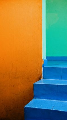 Moment: Bold. For the colors of the wall and door to be solid, primary colors, creating a simple, pronounced, bold effect in the image.