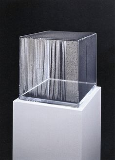 """Hans Haacke, Condensation Cube, (1965)  In 1962, Haacke began to make works such as Condensation Cube, which incorporate plexiglass containers filled with water in order to instantiate natural processes. The focus on natural processes such as condensation and evaporation reflects his early affiliation with the German """"Group Zero"""" and their experimentation with abstract form modified by phenomena such as light, shadow, reflection, and motion.  """"I have partially filled Plexi..."""