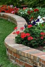 Image result for recycled red brick fence low