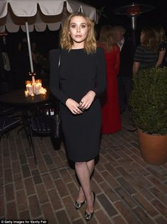 Chic: Actress Elizabeth Olsen looked incredible in her fitted LBD...