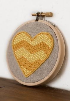 Embroidery heart i like the use of running stitch. is that running stitch? whatever that simple stitch is.