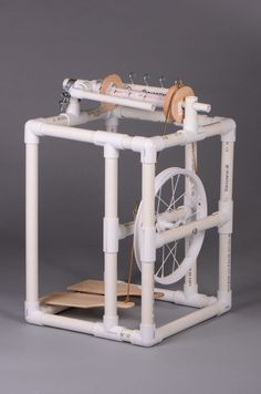 Build your own art yarn spinning wheel from PVC pipe and craft store supplies. Instructions and supply list are included in my book that will be published November Diy Spinning Wheel, Spinning Wool, Hand Spinning, Spinning Wheels, Pvc Pipe Crafts, Pvc Pipe Projects, Yarn Crafts, Pvc Tube, Art Du Fil