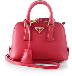 This bag is adorable! Perfect cross-body to pair with summer dresses or a pop of color in the winter!  Prada Saffiano Lux Double Handle Mini Satchel