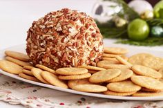 One bite of this creamy Cheese Ball with it's deliciously nutty exterior, and you will realize why it doesn't stick around for long.  #recipe #thanksgiving #appetizer