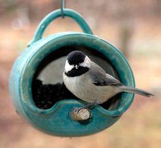 ceramic bird feeder [it's a mug on its side!]