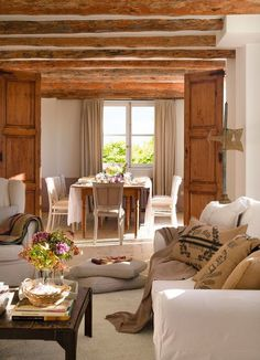 living room, dining room, wood ceiling beams