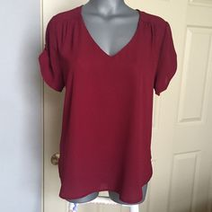 NWOT beautiful blouse This new without tags's blouse is very beautiful on. Longer in the back beautiful wine color. From a non-smoking home Meraki Tops Blouses