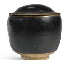 A rare black-glazed 'Cizhou' bowl and cover, Song-Yuan dynasty