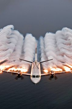 This picture is awesome! Looks like the plane is creating a tide as it is flying.