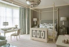 Soothing grey and white bedroom with a stunning silver chandelier for that extra oomph