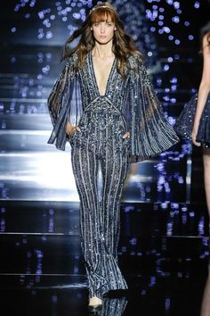 I always love a disco jumpsuit—and when it's covered in sequins and beads like this Zuhair Murad number, even better.