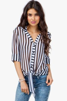 There's something so classic about stripes. This tie front blouse has a wide striped body and a lightweight, sheer chiffon body. Button front closure.