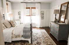 Curtains close to ceiling, dresser painted same hue as upper wall color, large rug under bed, Colorado and layers of bedding decor Teenager Dream Bedroom, Home Bedroom, Bedroom Decor, Farm Bedroom, Bedroom Furniture, Bedroom Wall, Farmhouse Master Bedroom, Dark Furniture, Pretty Bedroom