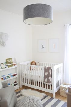 "Name: Oliver (2 months) Location: River Forest, Illinois I had so much fun planning my son Oliver's nursery. I chose to go with a clean, modern scheme with lots of gray, taupe, black, and white and touches of natural wood, faux fur, stars, and stripes. I think it will be appropriate for both boys and girls in years to come. And let's be honest: this is totally my ""mom cave"" so the calming palette is 100% intended for me! I do like how the book covers in the bookcase add a little splash ..."