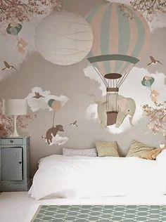 Hot air balloons are a charming trend for kids rooms, as they are so whimsical, they offer the romantic atmosphere of another era a...