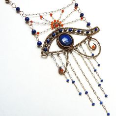 Handmade eye of Horus wire wrapped necklace, with Lapis Lazuli, deep orange Carnelian and Pyrite gemstones. AssiaDesigns on etsy. Egyptian inspired jewelry.
