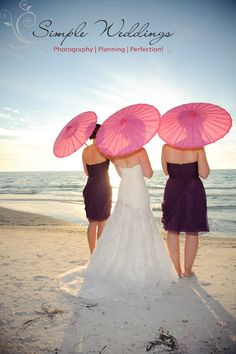 Pretty in Pink! These pink parasol umbrellas really pop at this beach wedding on Anna Maria Island, Florida!