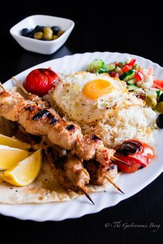Persian Joojeh {Chicken} Kebab on a bed of Chelo, Fried Egg and Salad Shiraza1