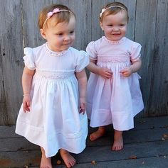 Adorable twins Sadie and Samantha are looking absolutely precious in their Rose Garden smocked dresses! This dress has always been a favorite! Available in white, pink & blue in sizes Newborn-4t! http://www.feltmanbrothers.com/