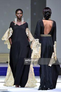 Models present creations by designer Pepita during the 10th 'Afrik' fashion show in Abidjan on June 14, 2015. AFP PHOTO / ISSOUF SANOGO