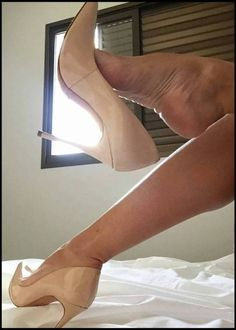Nude pumps, great feet, and popped heel