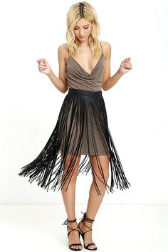"""Tell us the occasion where we can rock the Wind and Where Black Fringe Belt, and we will be there! Black vegan leather belt (with push stud closures) is finished with a row of 27"""" long fringe for a skirt-inspired look. Seven hole adjustments. Belt measures 36"""" long."""