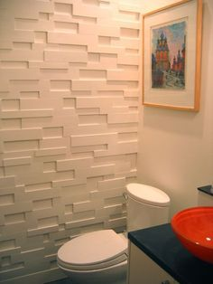 Create a textured wall with leftover MDF. Love this look and it only cost $6!