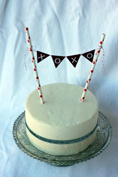 I made this cake dummy from Styrofoam rounds and covered it with fondant. I use it to display the mini bunting cake toppers  that I sell i...