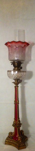 Top Quality Oil Lamp~Possibly Victorian~Cranberry glass shade~Gilt mounts~Porcelain stem leading to a cut glass font~Circa 1880