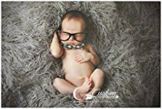 50 Ideas for Newborn Photography - Tons of great tips and examples including newborn pose ideas and props!