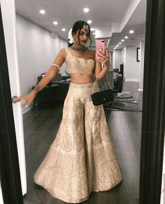 this was a lehenga turned into sharara with unique top style Sharara Designs, Kurti Designs Party Wear, Lehenga Designs, Indian Gowns Dresses, Indian Fashion Dresses, Indian Designer Outfits, Pakistani Dresses, Seoul Fashion, New York Fashion