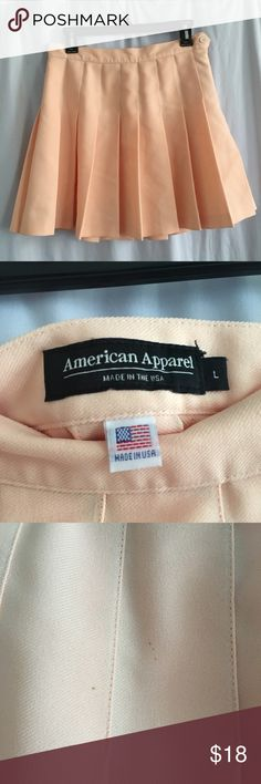 american apparel peach tennis skirt peachy peach high waisted pleated american apparel tennis skirt. size large, measures 28 inches  only worn once! has a few imperfections (3rd pic) but it's hardly noticeable.   price negotiable American Apparel Skirts Mini