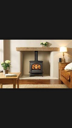 Huntingdon 30 matt black stove with light wood and small hearth. I want this look but matt ivory