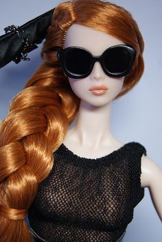 Fashion Doll with a red hair made into a braid .
