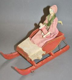 outstanding-antique-wooden-Grodnertal-doll-with-baby-and-original-sleigh-1820-30