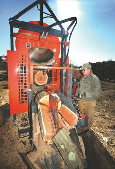 Kevin Penso, owner of Penso Firewood, splits wood at the family's Dennison-area business Friday. Penso Firewood works with HARCATUS to help .