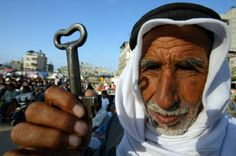 Palestinian man holds the key to his house.