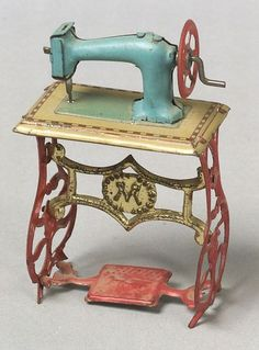 German Lithographed Tin Sewing Machine Penny Toy