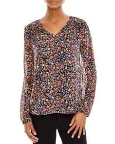 Daniel Rainn Floral Print Blouse   Polyester; lace: cotton/nylon; lining: polyester   Hand wash   Imported   Round neckline, long sleeves, elasticized cuffs   Shirred detail at front, contrast eyelet