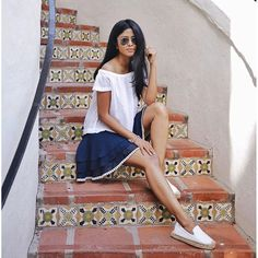 A white off-the-shoulder top with a tiered skirt and espadrille flats